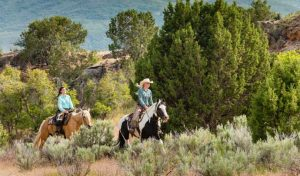 Two women on horseback at Red Ledges