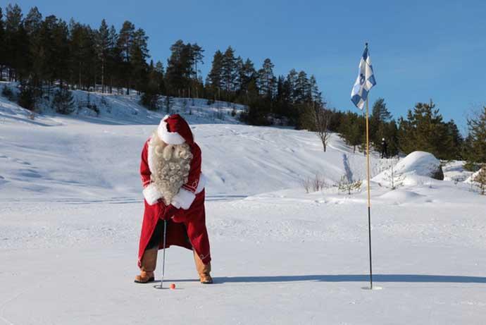 Santa Claus golfing in snow