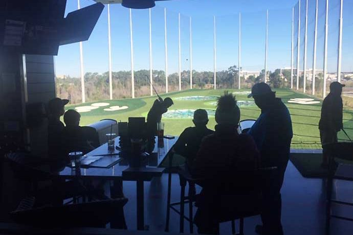 Golfers at Topgolf Florida