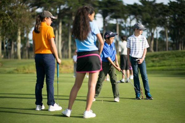 Kids on a putting green