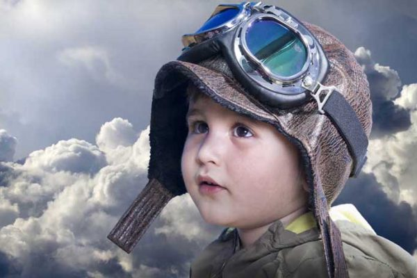 child in aviation googles dreaming of flying