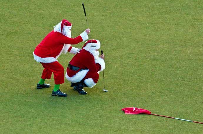 Santa putting on a golf green