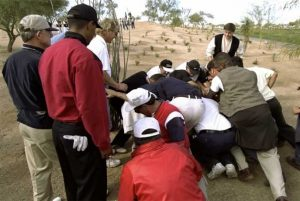 Tiger Woods watches fan move a boulder at the 1999 Waste Management Phoenix Open