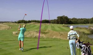 Woman hits drive tracked by Toptracer technology